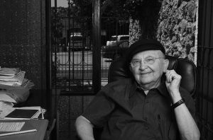AHARON APPELFELD, FAMOUS ISRAELI AUTHOR WEARING HIS CASKET HAT, AT HIS WORKING ROOM. MEVASERET ZION, ISRAEL. July, 2012.