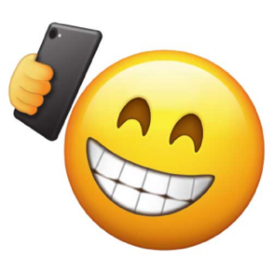grinning_taking_selfie