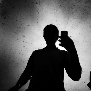 Silhouette Of Man Holding Smart Phone